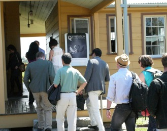 Q Symposium guests entering the coffee break and conference rooms area at the Q Station