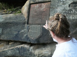 Alison Bashford, historian at the University of Sydney, telling some of the stories behind the stones. This one shows the name of the ship, date of arrival, and the names of some of those on board.