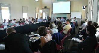 Conference room full of participants during panel
