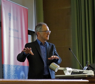 "CISS Director James Der Derian introduces McKenzie Wark and his lecture, ""Exit to the Planetarium"". Photo: Gilbert Bel-Bachir."