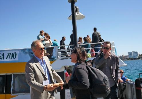 James Der Derian welcomes the first arrivals to the Q Station. Photo: Gilbert Bel-Bachir.