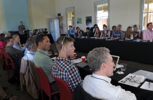 Various Symposium attendees listening to the presentations. Photo: Gilbert Bel-Bachir.