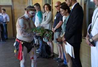 Custodian Matthew Doyle brings the smoking eucalyptus leaves as part of the purifying ceremony. Photo: Gilbert Bel-Bachir.